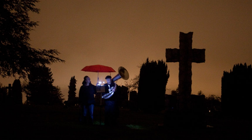 Dressed in rain gear, Mark Haney's brass band slouched into the cemetery