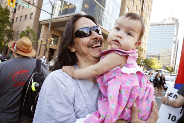 Dan Wallace with baby daughter - Vancouver Enbridge rally - Mychaylo Prystupa