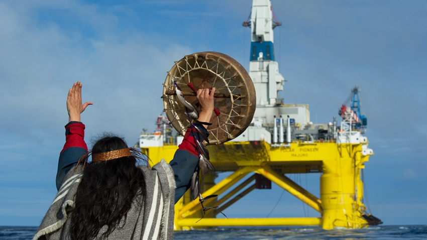 Audrey Siegl addresses the Shell oil rig platform. Greenpeace photo