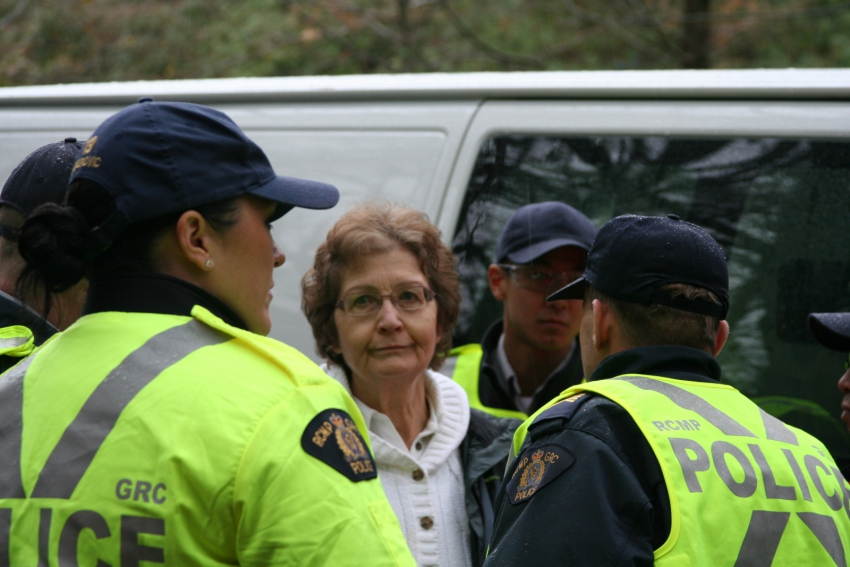 Della  Glendenning being arrested on Burnaby Mountain for Kinder Morgan protest
