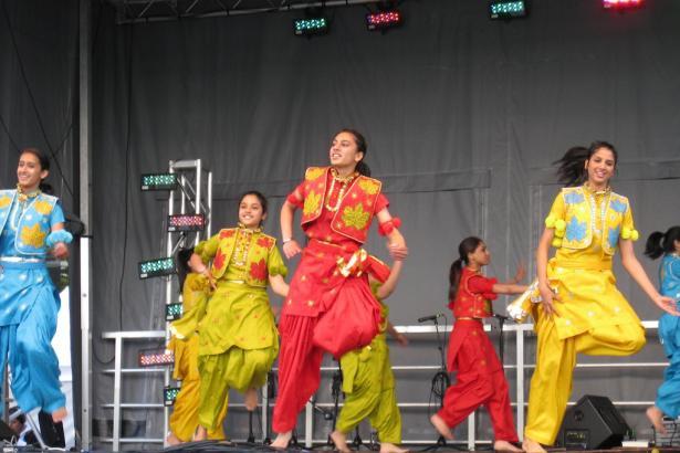 Female bhangra dancers performing in unison
