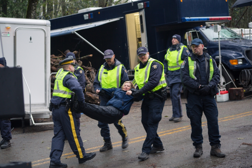 Karen Mahon being arrested at Kinder Morgan protest on Burnaby Mountain
