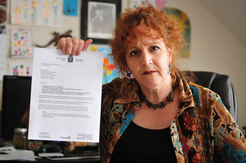 Louisette Lanteigne Waterloo resident holding NEB letter - photo James Jackson