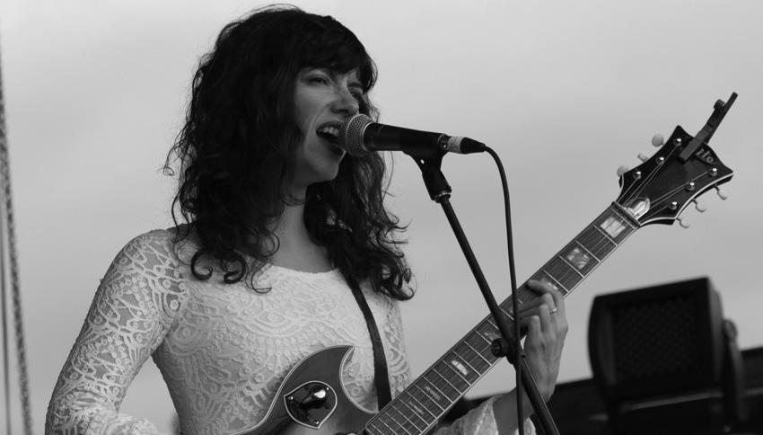 Natalie Prass playing guitar and singing