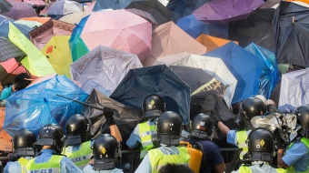 Hong Kong riot police at Umbrella Revolution protest - Derek Yung