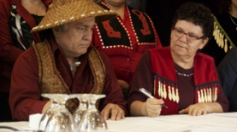 Chief Maureen Thomas signs the International Treaty to Protect the Sacred
