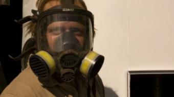 Karl Mattson wears a gas mask.