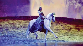 Cavalia's Odysseo final scene with dressage horse on the edge of a lake