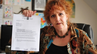 Louisette Lanteigne Waterloo resident holding NEB letter - photo James Jackson