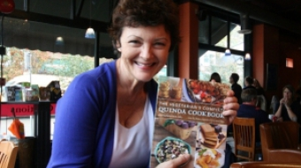 Mairlyn Smith displays her new cookbook.