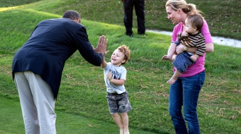 Obama high five with kid