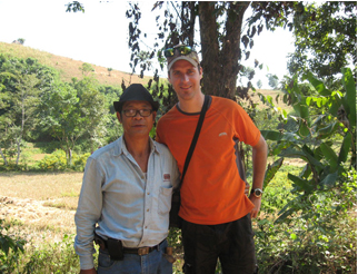 My uncle Gun and I outside a Lahu village
