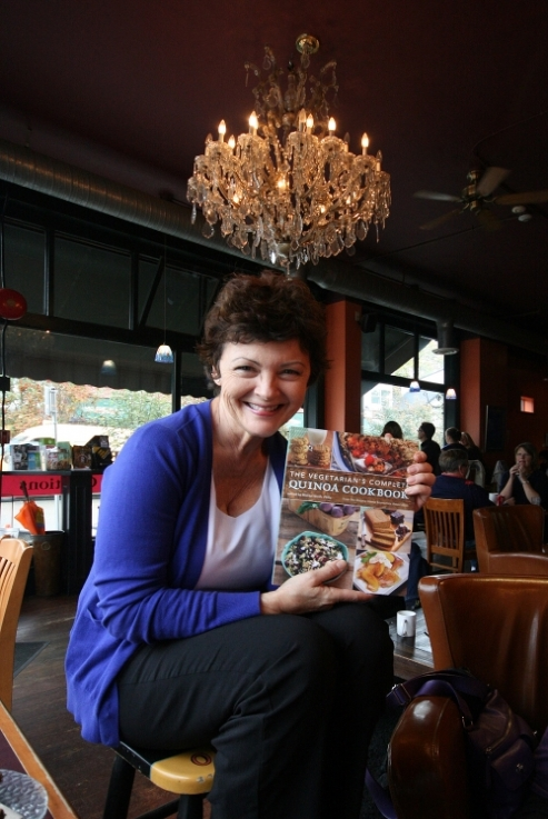 Mairlyn Smith displays cookbook.