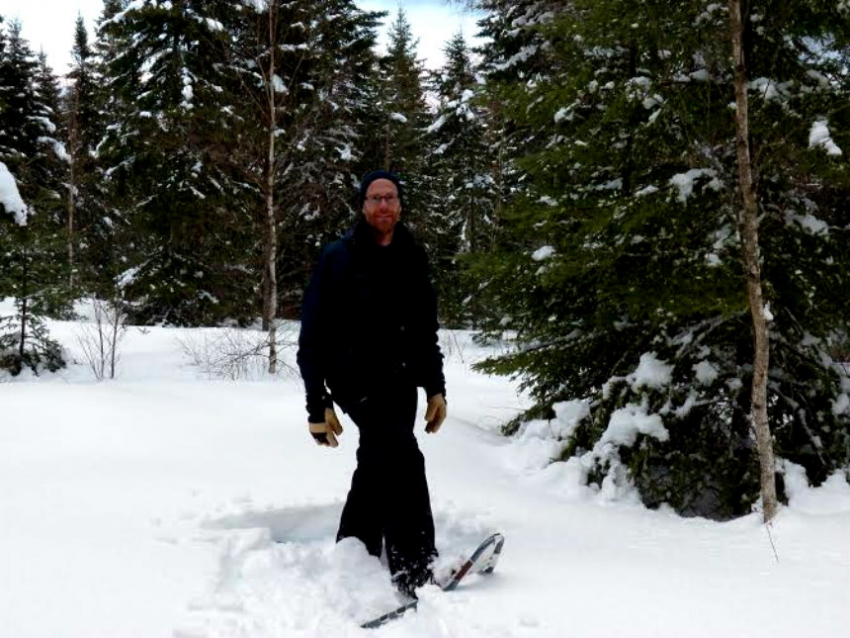 Rick Verge snowshoeing on his land