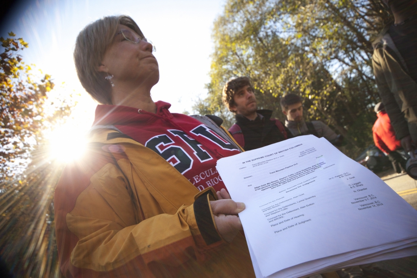 SFU Biochemist Lynne Quarmby with Kinder Morgan injunction against protesters