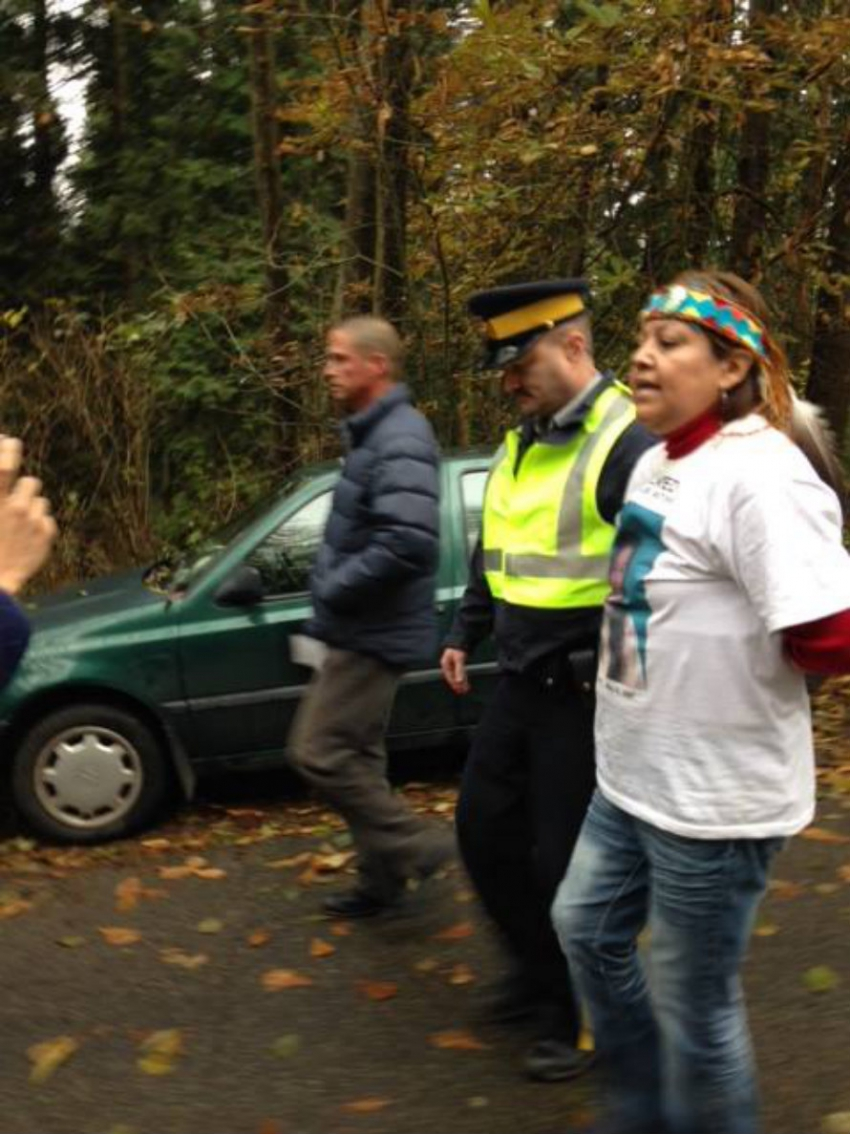 Sut-Lut being arrested on Burnaby Mountain