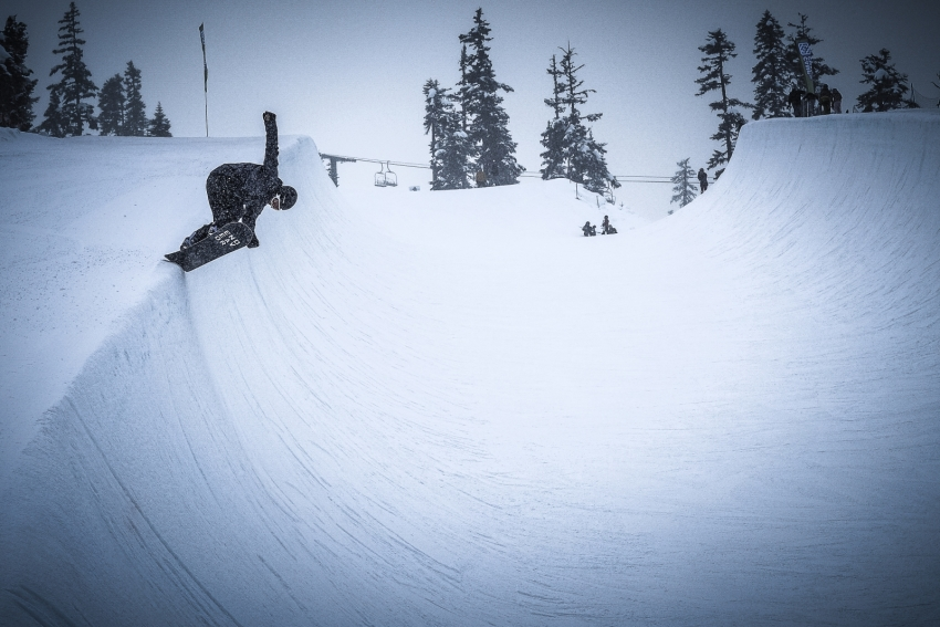 Snowboarder hits the Blackcomb Halfpipe